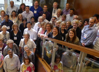 Callout Image - Photo from symposium of members on a stairwell - Children's Hospitals Neonatal Consortium CHNC