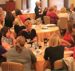 Callout Image - Photo from symposium of 8 members collaborating at a table - Children's Hospitals Neonatal Consortium CHNC